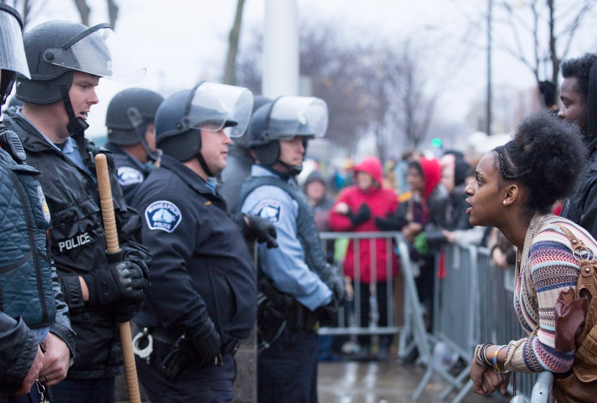 Police and protesters engage in a tense standoff at the 4th police precinct after the killing of Jamar Clark, November 18, 2015